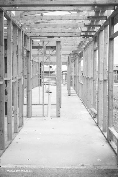 House framing erected atop a concrete slab.