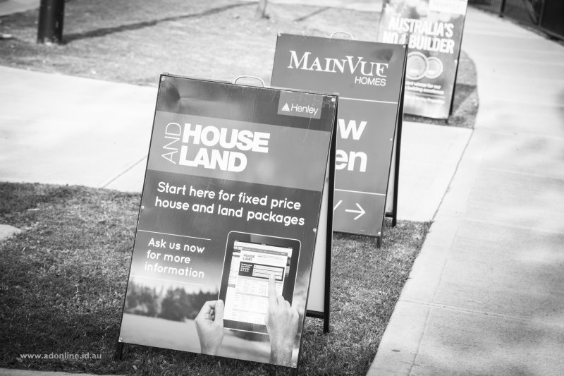 Sandwich boards advertising houses open for inspection.