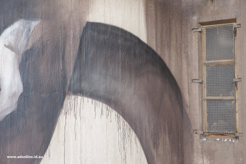 Spray paint on a wall with drips.