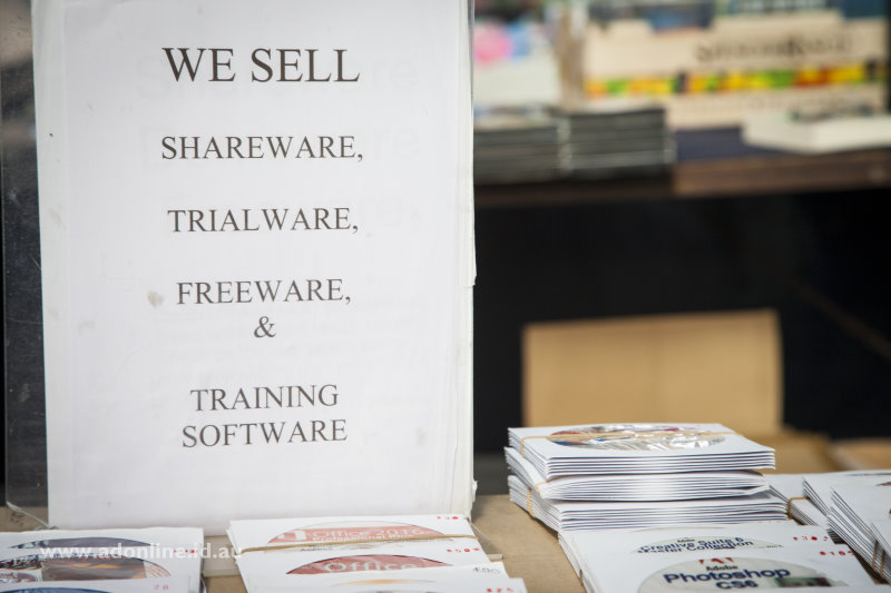 Sign advertising the sale of shareware and freeware beside copies of Adobe Photoshop.