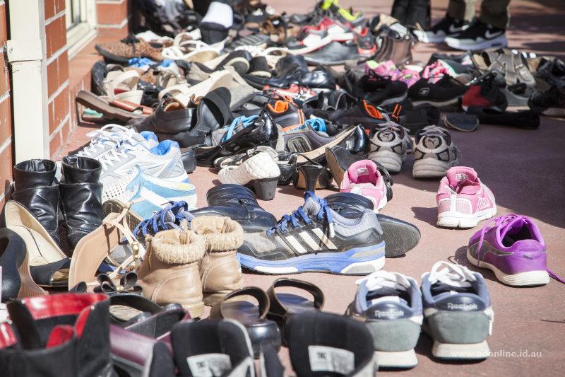 Shoes scattered outside the door of Wat Monirangsi.