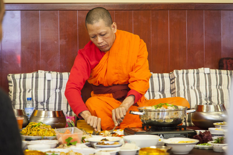 A Buddhist monk having lunch during Pchum Ben.