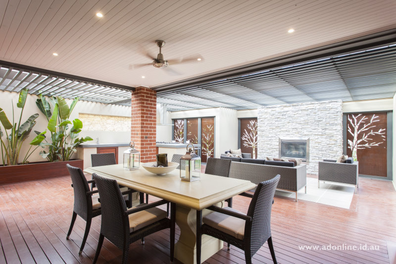 Al frsco area with fan, kitchen benches, sink, barbecue and little outdoors