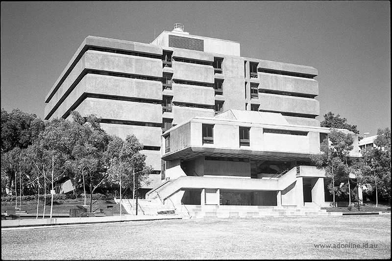 Black and white photo of brutalist building photographed from ground level