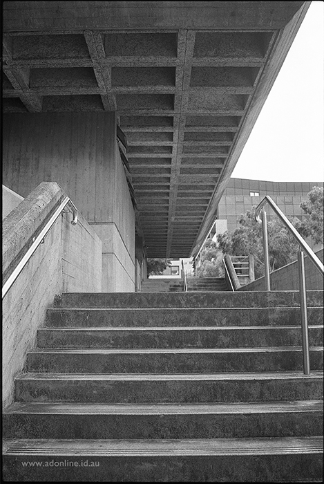 The stairway up to G08 at the University of Sydney, showing the waffle ceiling and heavy concrete design elements.