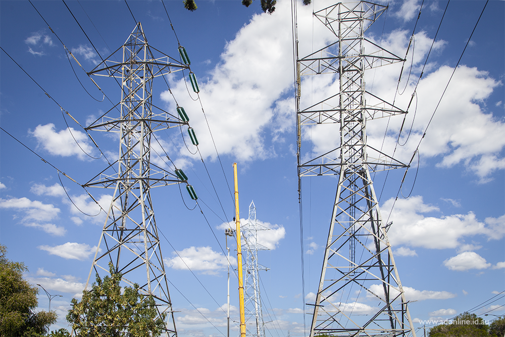 Transmission lines with blue sky behind.