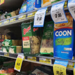 Coon brand cheese on a supermarket shelf in Australia with other brands of cheese.