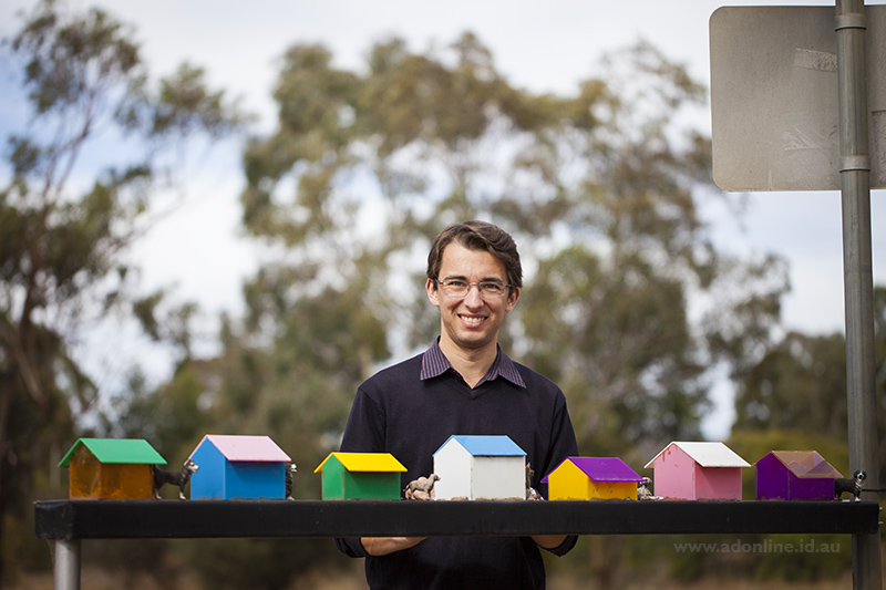 Adam Dimech standing beside a sculpture at Kennel Road, Ararat