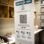 A poster with a QR code printed on it in a restaurant
