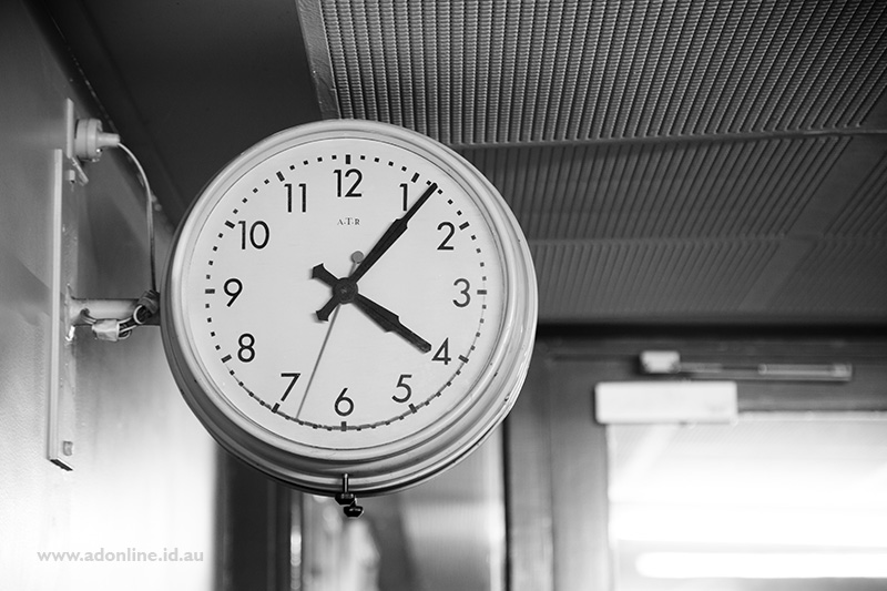 Electric analogue clock on the wall