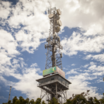 Photo of telecommunications tower with trees below