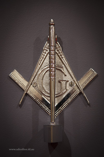 Door knocker cast in the shape of freemason logo