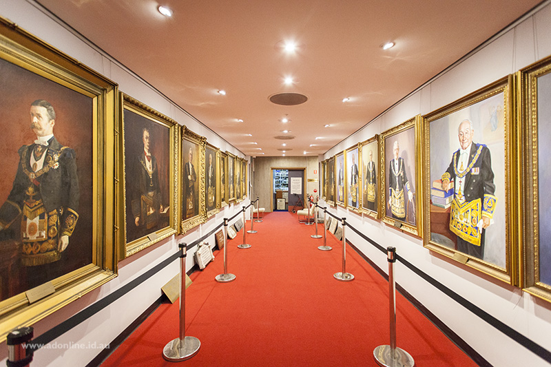 Corridor with portrait paintings down both sides