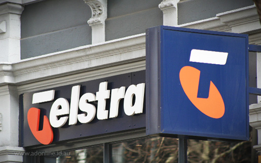 Telstra sign in front of a Telstra Shop